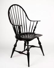 Continuous arm armchair